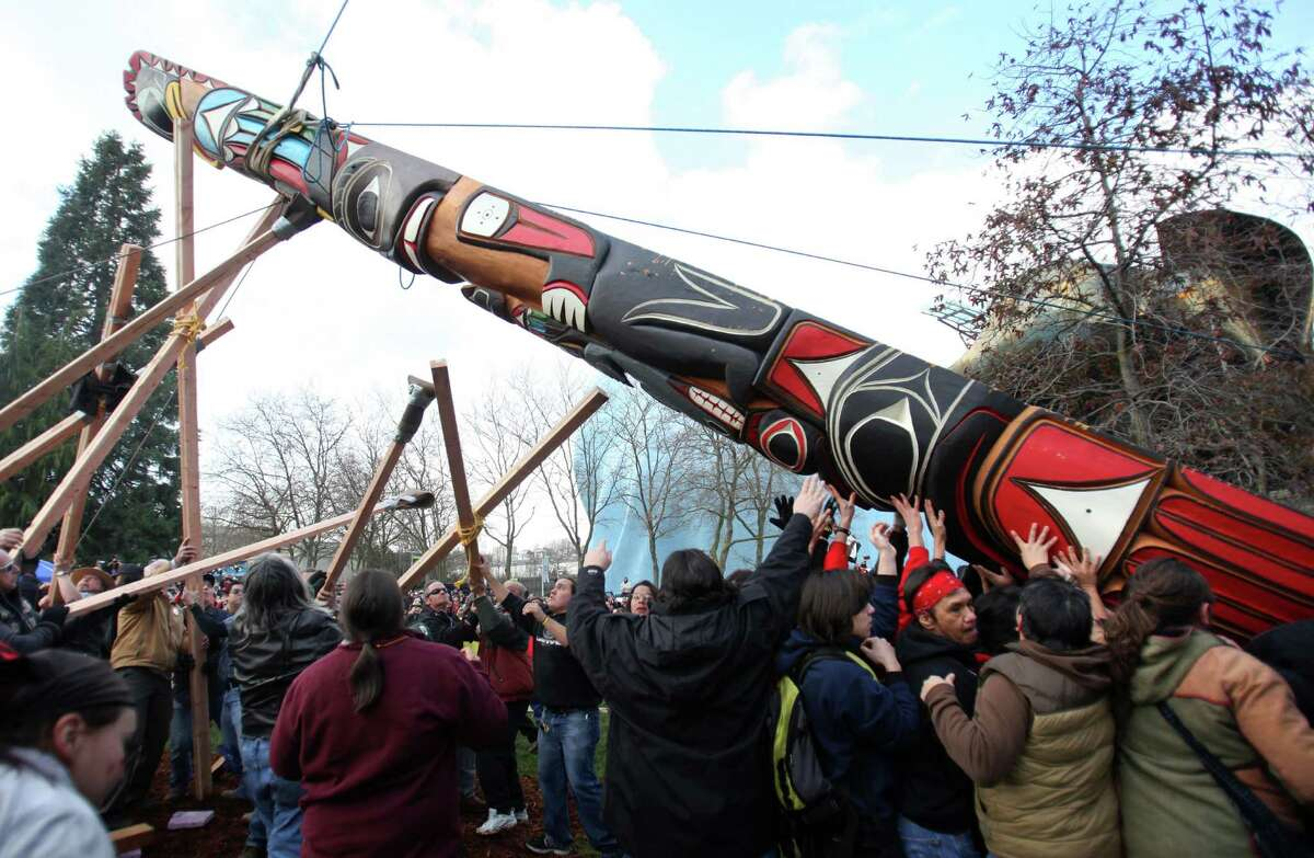 February 26, 2012 - People use ropes, wood poles and good-old-fashioned muscle to raise a totem pole estimated to weigh nearly 5,000 pounds at the Seattle Center after a procession from pier 57 in Seattle. The 33-foot tall totem pole was erected in honor of slain Native American woodcarver John T. Williams. Williams was shot and killed by a Seattle Police officer in 2010. The shooting was later ruled unjustified. More here.