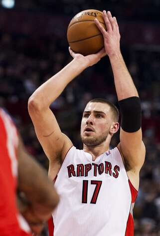 Raptors forward Jonas Valanciunas shoots against the Rockets. (Aaron Vincent Elkaim / Associated Press)