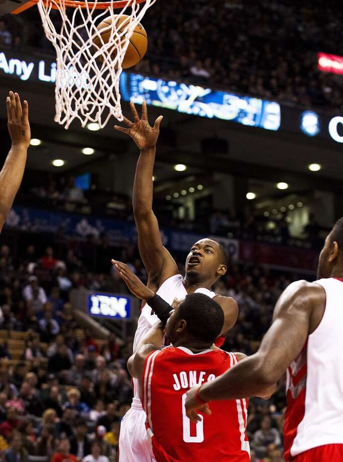 Raptors guard Terrence Ross shoots over Rockets forward Terrence Jones. (Aaron Vincent Elkaim / Associated Press)