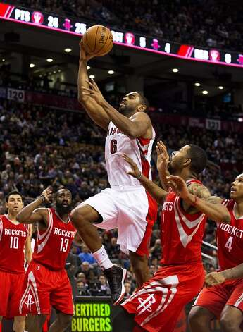 Alan Anderson of the Raptors goes to the basket against the Rockets. (Aaron Vincent Elkaim / Associated Press)