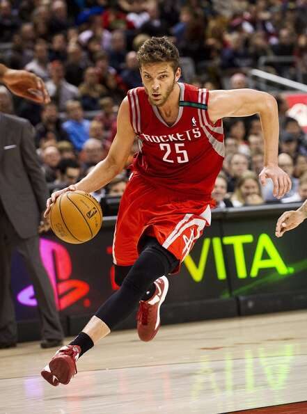 Rockets forward Chandler Parsons advances the ball against the Raptors. (Aaron Vincent Elkaim / Asso