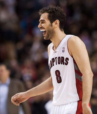 Raptors guard Jose Calderon reacts after defeating the Rockets. (Aaron Vincent Elkaim / Associated Press)