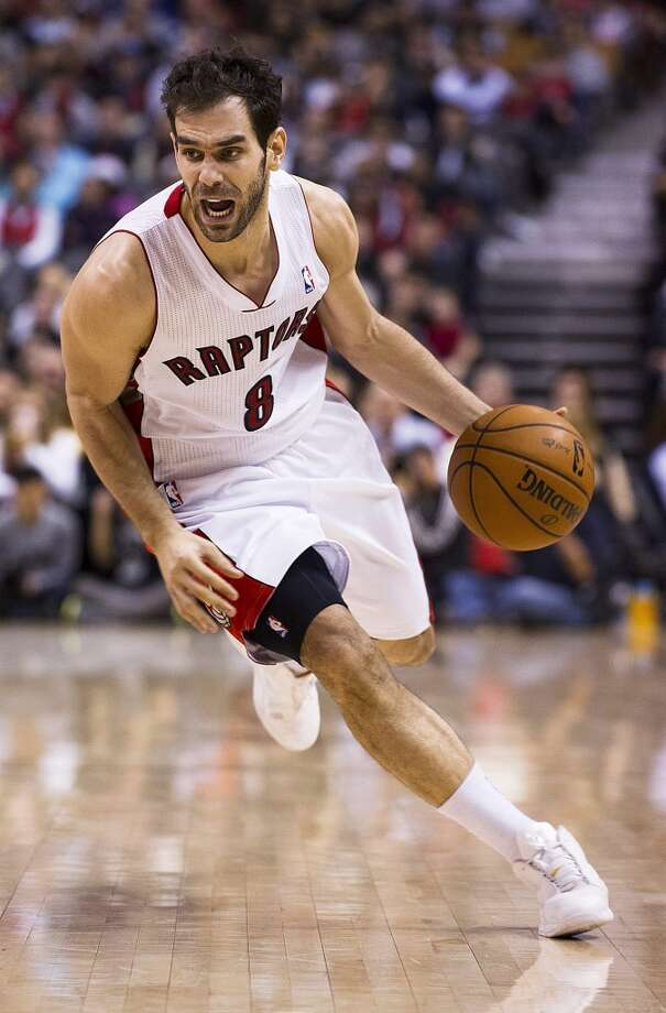 Raptors guard Jose Calderon drives down court. (Aaron Vincent Elkaim / Associated Press)