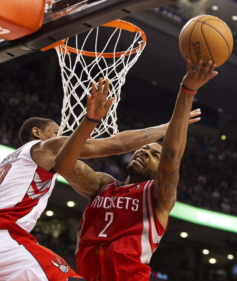 Rockets forward Marcus Morris is fouled by Raptors guard DeMar DeRozan. (Aaron Vincent Elkaim / Associated Press)