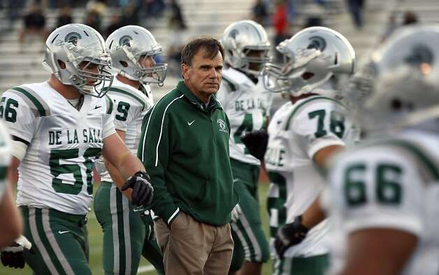 Bob Ladouceur head coach of De La Salle's nationally renowned football team, watches warm ups prior to the start of their game with Foot Hill High School Friday October 7, 2011. Photo: Lance Iversen, The Chronicle