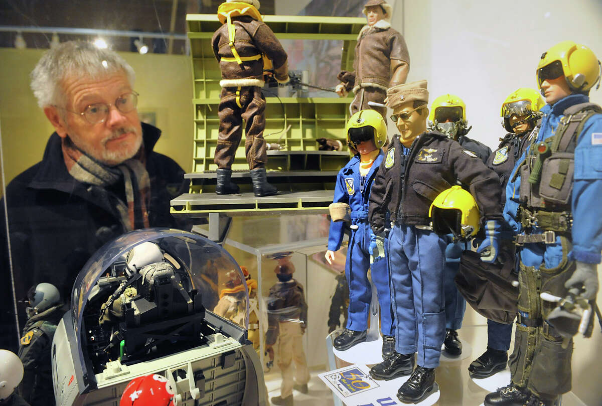 Michael Aikey, director NYS Military Museum and Veterans Research Center, looks in a case at a GI Joe