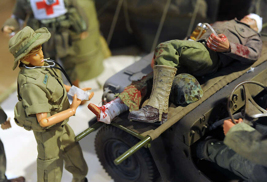 GI Jane, left, is represented in a scene under a case at a GI Joe