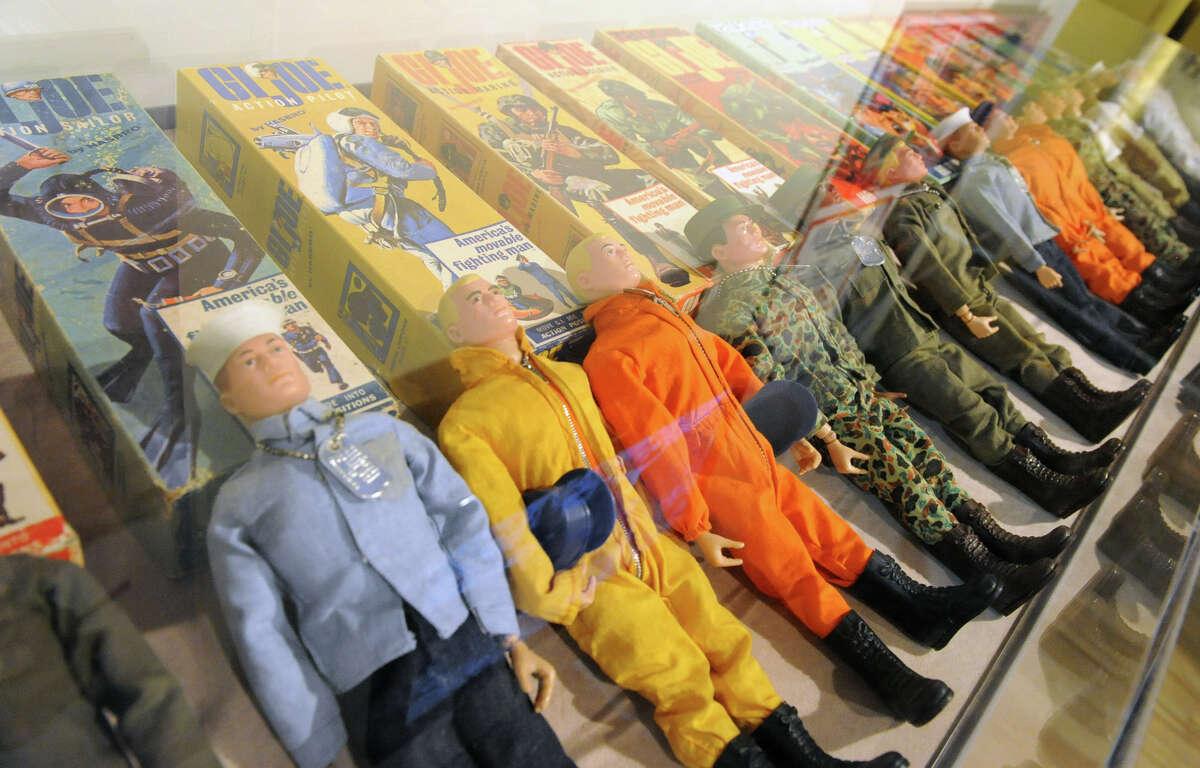 A case full of GI Joe dolls at the