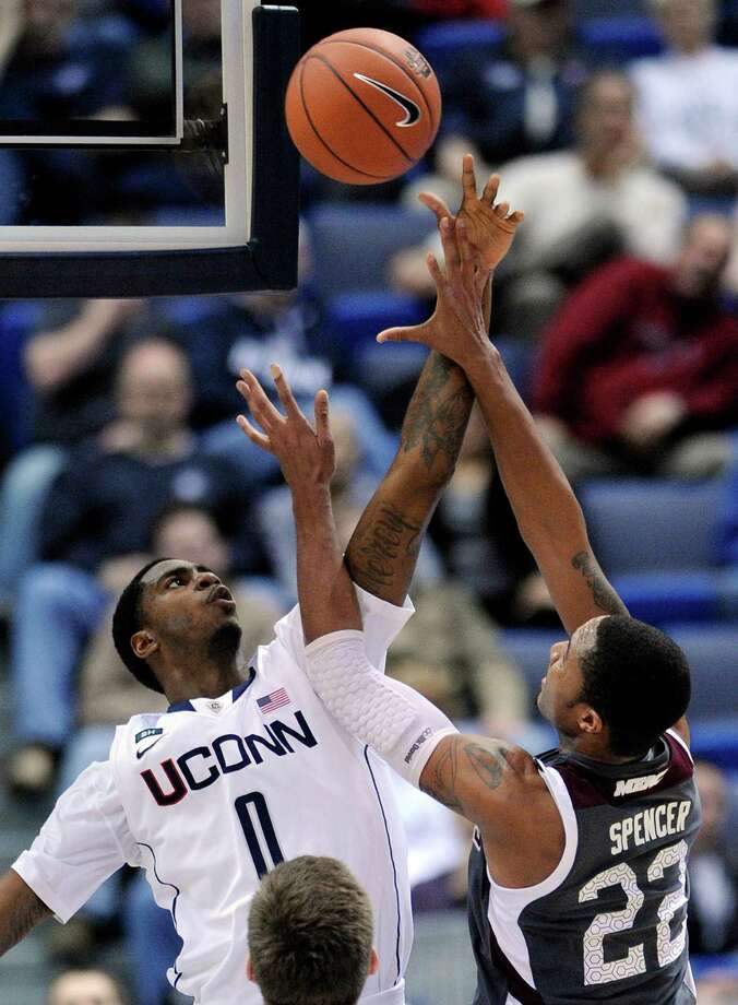 Connecticut's Phillip Nolan, left, guards Maryland Eastern Shore's Ron Spencer during the first half of an NCAA college basketball game in Hartford, Conn., Monday, Dec. 17, 2012. (AP Photo/Fred Beckham) Photo: Fred Beckham, Associated Press / FR153656 AP