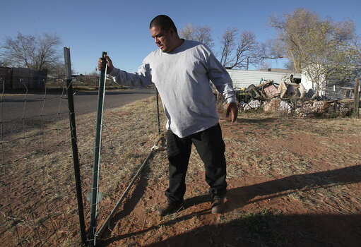 Joe Cobarobio closes the gate to his place in Midland, TX. Cobarobio is a witness of the freight train wreck in Midland, TX last Nov. 15, who took a video and photos of the incident, at the scene of the fatal crash as it happened, Monday, Dec. 17, 2012. Photo: Bob Owen, San Antonio Express-News / © 2012 San Antonio Express-News