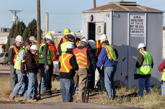 Lawyers and their crime scene data technicians gather evidence at the Union Pacific Rail Road Signal Cabin at Garfield Street in Midland, TX, where four were killed when their parade float was struck by a fast moving train Nov. 15, 2012. Monday, Dec. 17, 2012. Photo: Bob Owen, San Antonio Express-News / © 2012 San Antonio Express-News