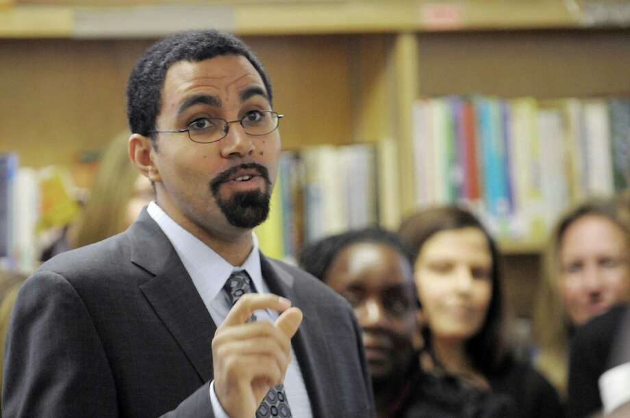 State Education Commissioner John King Jr. addresses those gathered for an event at Schenectady High School to honor teachers from around New York State who have become National Board-Certified teachers on Monday, Dec. 17, 2012 in Schenectady, NY.   (Paul Buckowski / Times Union) Photo: Paul Buckowski  / 00020478A