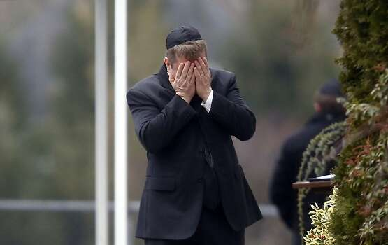 A mourner arrives at the funeral service for 6-year-old Noah Pozner, Monday, Dec. 17, 2012, in Fairfield, Conn. Pozner was killed when a gunman walked into Sandy Hook Elementary School in Newtown Friday and opened fire, killing 26 people, including 20 children. (AP Photo/Jason DeCrow) Photo: Jason DeCrow, Associated Press