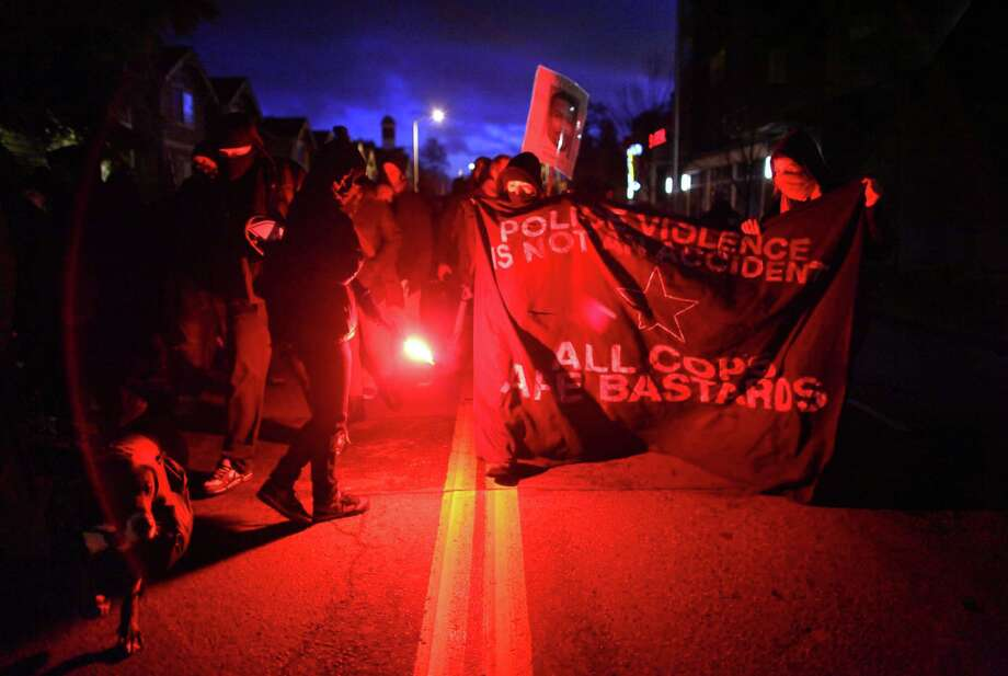 January 14, 2012— Protesters, many wearing masks, march on 23rd Avenue to the Seattle Police Department's East Precinct while carrying road flares. Participants in the rally were demanding that Chief John Diaz step down. About 50 people participated in the march. Story here. Photo: JOSHUA TRUJILLO / SEATTLEPI.COM