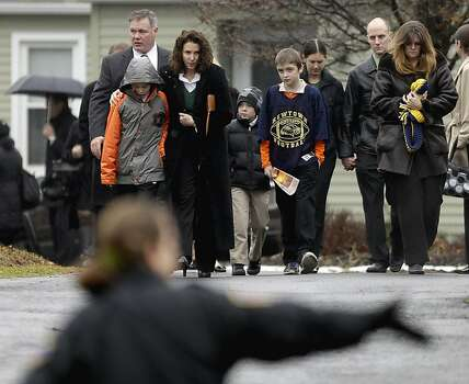Mourners leave the funeral service of Sandy Hook Elementary School shooting victim, Jack Pinto, 6, Monday, Dec. 17, 2012, in Newtown, Conn. Pinto was killed when a gunman walked into Sandy Hook Elementary School in Newtown Friday and opened fire, killing 26 people, including 20 children.(AP Photo/David Goldman) Photo: David Goldman, Associated Press