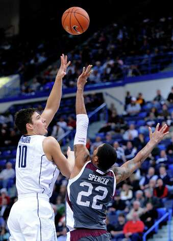 Connecticut's Tyler Olander, left, shoots over Maryland Eastern Shore's Ron Spencer during the first half of an NCAA college basketball game in Hartford, Conn., Monday, Dec. 17, 2012. (AP Photo/Fred Beckham) Photo: Fred Beckham, ASSOCIATED PRESS / AP2012