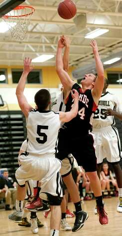 Fairfield Warde high school's Max Garrett fights for a rebound in a boys basketball game against Trumbull high school played at Trumbull high school, Trumbull, CT on Monday December 17th, 2012. Photo: Mark Conrad / Connecticut Post Freelance