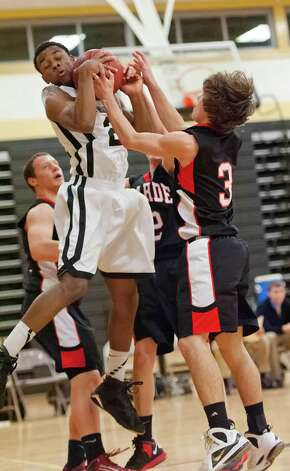 Trumbull high school's John Watts pulls down a rebound in a boys basketball game against Fairfield Warde high school played at Trumbull high school, Trumbull, CT on Monday December 17th, 2012. Photo: Mark Conrad / Connecticut Post Freelance