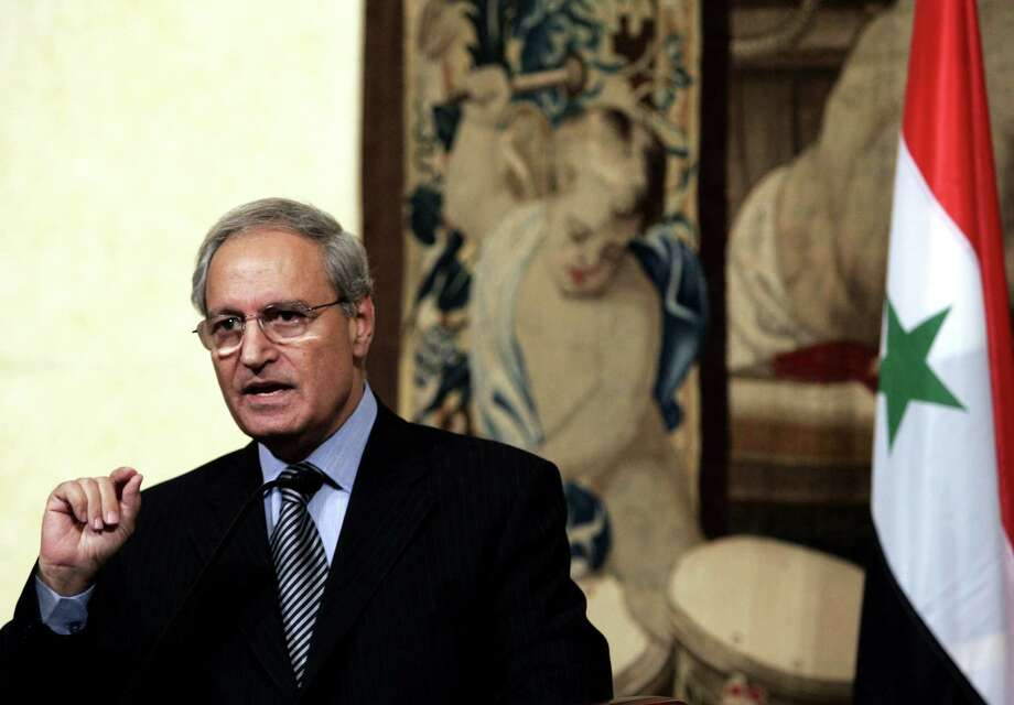 FILE - In this Thursday, Sept. 6, 2007 file photo, Syrian Vice President Farouk al-Sharaa talks to journalists during a joint press conference with Italian Premier Romano Prodi at Chigi palace, in Rome. Syria's longtime vice president said the army cannot defeat the rebels fighting to topple the regime, the first admission by a top government official that a victory by President Bashar Assad is unlikely. (AP Photo/Gregorio Borgia, File) Photo: Gregorio Borgia