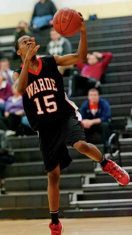 Fairfield Warde high school's Terrance Walden goes up for a layup in a boys basketball game against Trumbull high school played at Trumbull high school, Trumbull, CT on Monday December 17th, 2012. Photo: Mark Conrad / Connecticut Post Freelance