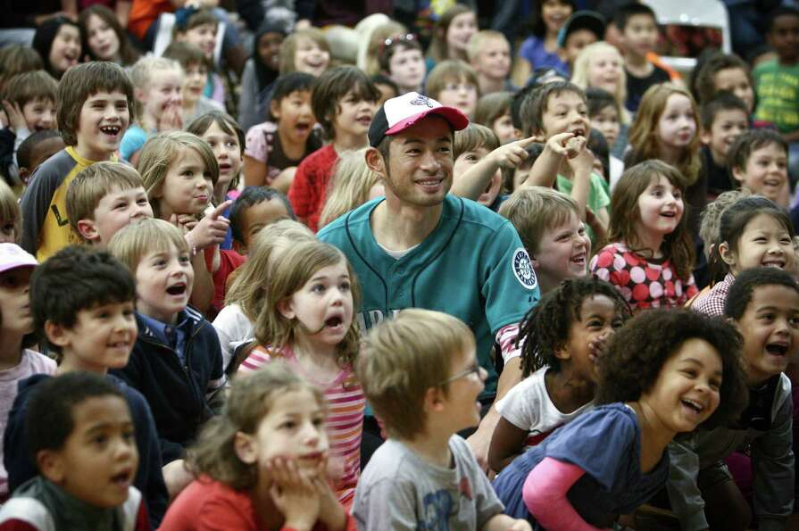 May 8, 2012 — Seattle Mariners player Ichiro Suzuki sits with students during the annual D.