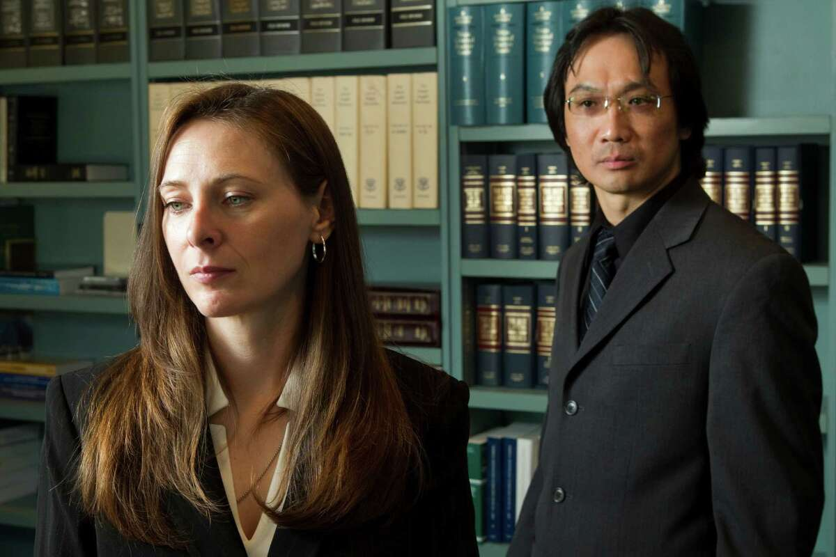 Amanda Culbertson, left, and Jorge Wong contend in a lawsuit that they were victims of retaliation when the District Attorney's Office lobbied the Commissioners Court to cancel a contract with a company where they had found employment.