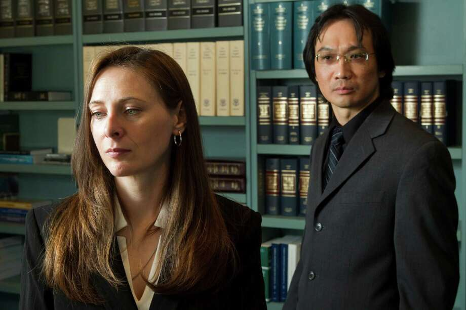 Amanda Culbertson, left, and Jorge Wong  contend in a lawsuit that they were victims of retaliation when the District Attorney's Office lobbied the Commissioners Court to cancel a contract with a company where they had found employment. Photo: Brett Coomer, Houston Chronicle / © 2012 Houston Chronicle