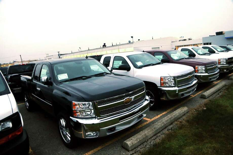 Chevrolet Silverado pickup trucks are for sale at a dealership in Troy, Mich. General Motors is matching or beating discounts from rivals Ford and Chrysler on pickups. Photo: Carlos Osorio, STF / AP