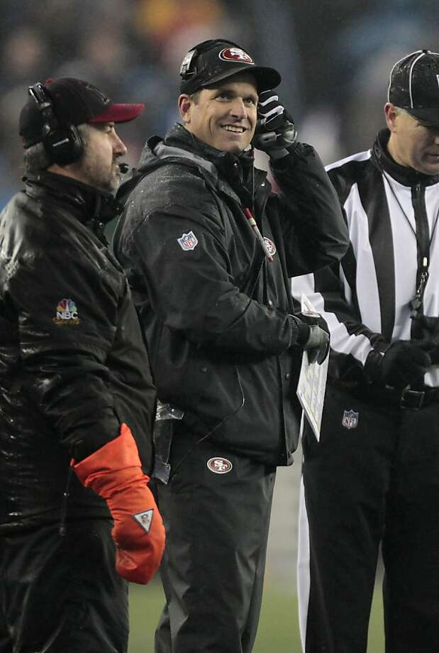 San Francisco 49ers head coach Jim Harbaugh smiles on the sideline in the second quarter an NFL football game against the New England Patriots in Foxborough, Mass., Sunday, Dec. 16, 2012. (AP Photo/Steven Senne) Photo: Steven Senne, Associated Press