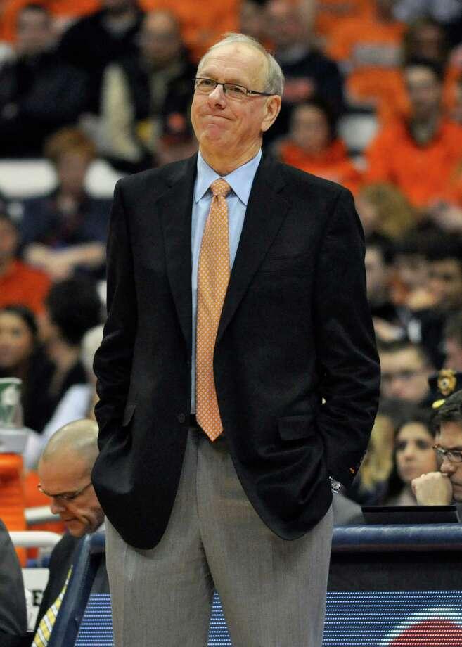 Syracuse coach Jim Boeheim watches during the first half of an NCAA college basketball game against Detroit in Syracuse, N.Y., Monday, Dec. 17, 2012. (AP Photo/Kevin Rivoli) Photo: KEVIN RIVOLI