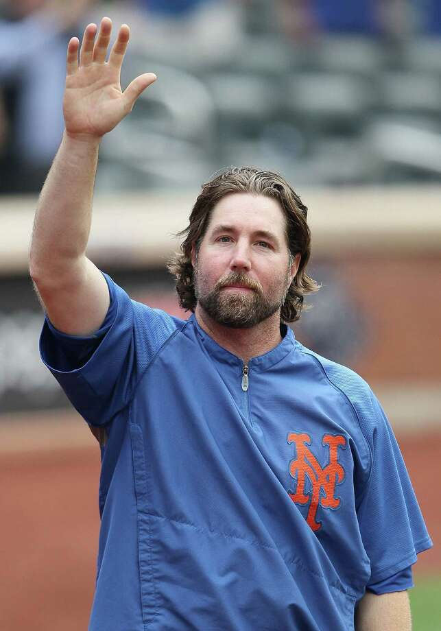 FILE - DECEMBER 17: According to reports December 17, 2012, R.A. Dickey agreed to a two-year $25 million contract extension with the Toronto Blue Jays, to complete a trade with the New York Mets.  NEW YORK, NY - SEPTEMBER 27:  R.A. Dickey #43 of the New York Mets acknowledges the crowd after being interviewed following his 20th win of the season against the Pittsburgh Pirates at Citi Field on September 27, 2012 in the Flushing neighborhood of the Queens borough of New York City.  (Photo by Alex Trautwig/Getty Images) Photo: Alex Trautwig