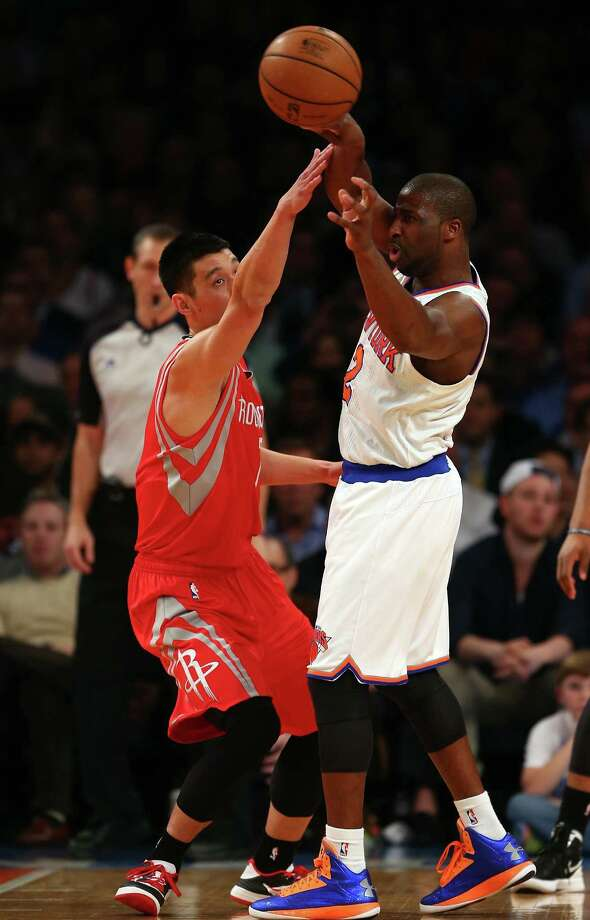 NEW YORK, NY - DECEMBER 17:  Raymond Felton #2 of the New York Knicks passes under pressure from Jeremy Lin #7 of the Houston Rockets on December 17, 2012 at Madison Square Garden in New York City. NOTE TO USER: User expressly acknowledges and agrees that, by downloading and/or using this photograph, user is consenting to the terms and conditions of the Getty Images License Agreement.  (Photo by Elsa/Getty Images) Photo: Elsa / 2012 Getty Images