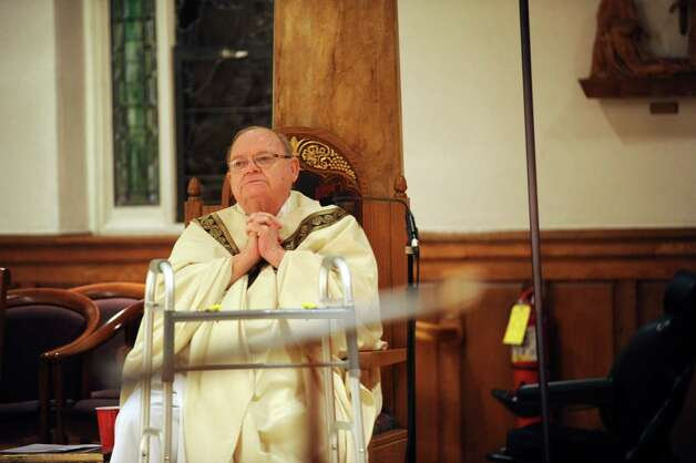 Reverend Monsignor Frank C. Wissel prays at a memorial and healing Mass for the shooting victims of Sandy Hook Elementary School and the entire Newtown community at St. Mary Church, in Greenwich, Conn., Monday, Dec. 17, 2012. Photo: Helen Neafsey / Greenwich Time