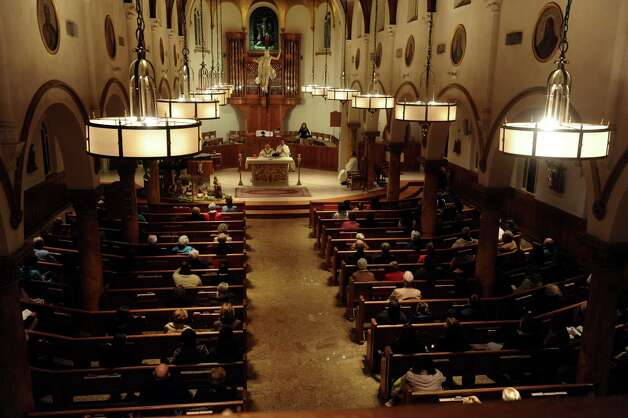 A memorial and healing Mass for the shooting victims of Sandy Hook Elementary School and the entire Newtown community at St. Mary Church, in Greenwich, Conn., Monday, Dec. 17, 2012. Photo: Helen Neafsey / Greenwich Time