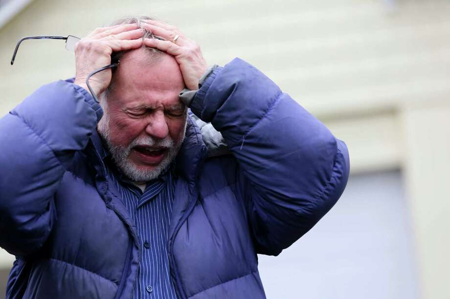 Gene Rosen gestures as he speaks during an interview with the Associated Press, Monday, Dec. 17, 2012 in Newtown, Conn. On the day of the shooting, Rosen took in four girls and two boys that were sitting at the end of his driveway; they had just run from the school, among the first to escape Friday's deadly shooting. He ran upstairs and grabbed an armful of stuffed animals he kept there. He gave those to the children, along with some fruit juice and sat with them as the two boys described seeing their teacher being shot. (AP Photo/Mary Altaffer) Photo: Mary Altaffer