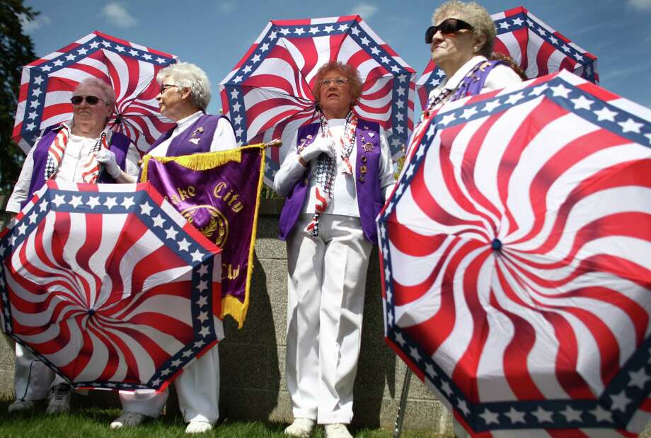 May 28, 2012— Members of the Lake City Emblem Club, from left, Ethel LaRose, Opal Johnson, Dianne Salmonsen, and Betty Edwards wait to parade during the annual Memorial Day celebration at the Evergreen-Washelli Seattle Veterans' Memorial Cemetery. The event was the 86th annual Memorial Day celebration held at Evergreen-Washelli cemetery. Photo: JOSHUA TRUJILLO / SEATTLEPI.COM