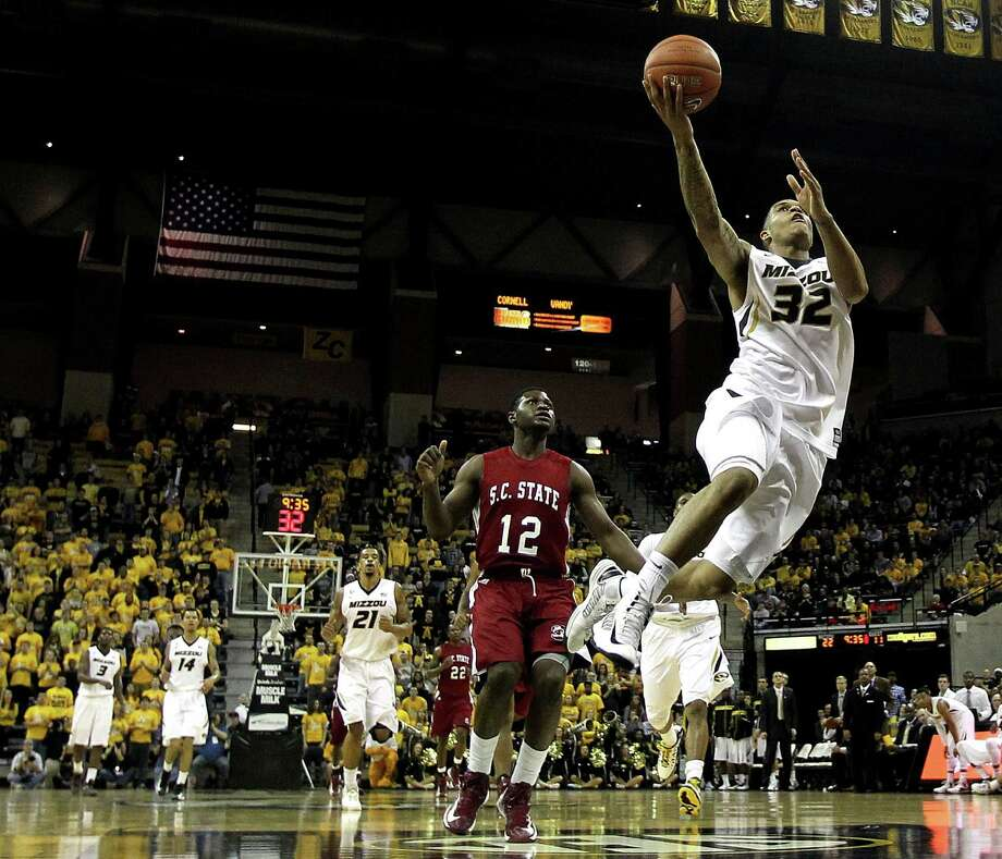 COLUMBIA, MO - DECEMBER 17:  Jabari Brown #32 of the Missouri Tigers shoots on a fast break as Shaquille Mitchell #12 of the South Carolina State Bulldogs defends during the game at Mizzou Arena on December 17, 2012 in Columbia, Missouri.  (Photo by Jamie Squire/Getty Images) Photo: Jamie Squire