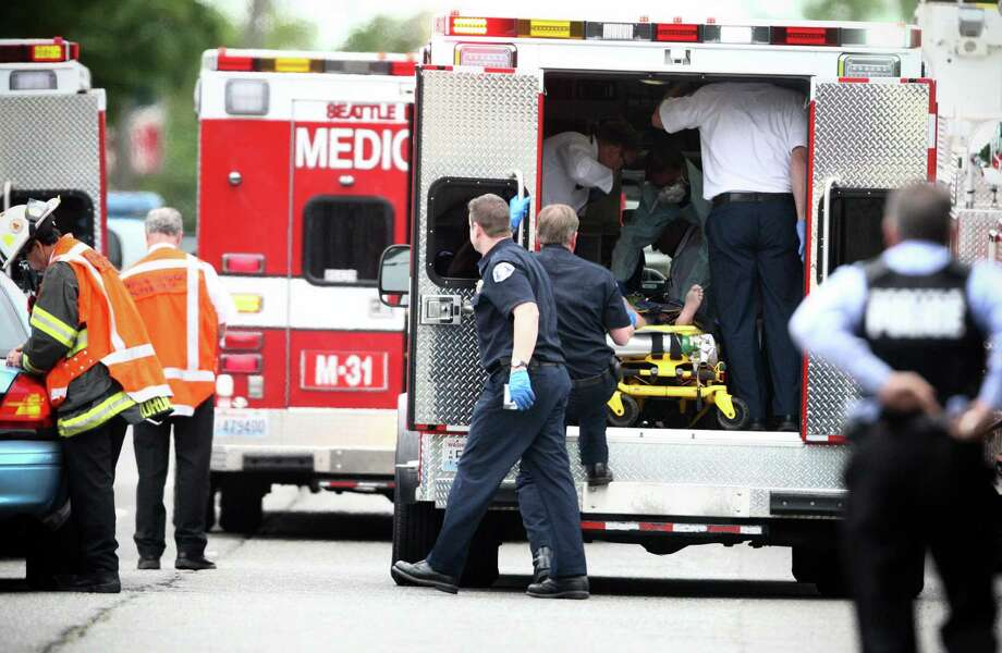 May 30, 2012— A victim is placed in an ambulance after four people were killed at Cafe Racer on Roosevelt Way NE in Seattle. The mentally unstable shooter later killed a woman outside Town Hall, took  her car and eventually shot himself as police closed in on him in West Seattle. The spree of violence shocked Seattle. Photo: JOSHUA TRUJILLO / SEATTLEPI.COM