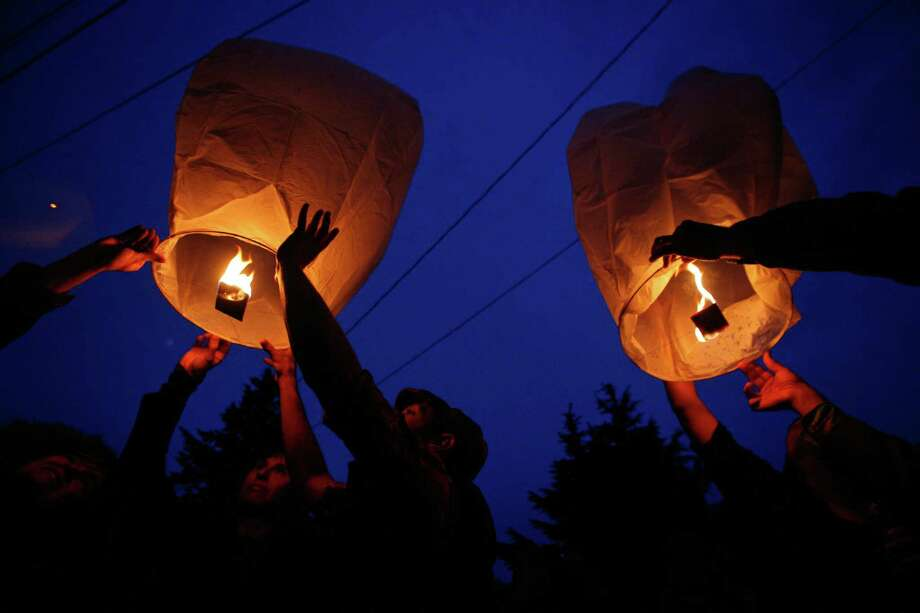 May 30, 2012 — Floating lanterns are lit during a vigil after five people were shot at Cafe Racer on Roosevelt Way NE. Four of the victims died from the violence. A fifth person was shot and killed in downtown Seattle about 30 minutes later. Seattle Police said they believed it was by the same suspect. The suspect later shot himself in West Seattle. Photo: SOFIA JARAMILLO / SEATTLEPI.COM