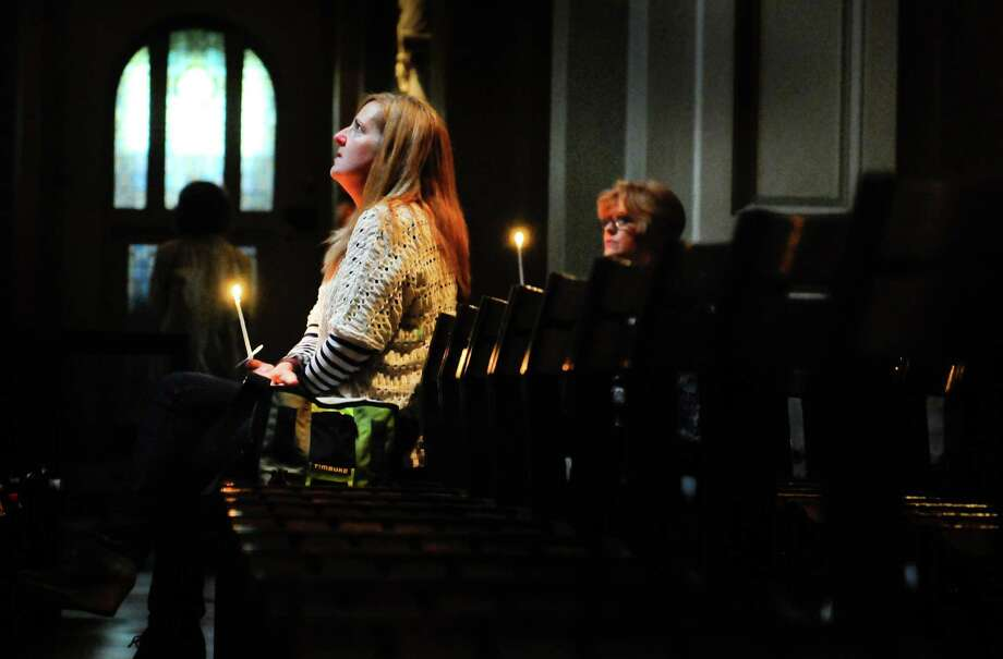 June 1, 2012— Suzanne Mercier, a close friend of Cafe Racer owner Kurt Geissel, looks skyward during a prayer service at St. James Cathedral for the victims of the violence. Six people, including the shooter died. Photo: LINDSEY WASSON / SEATTLEPI.COM