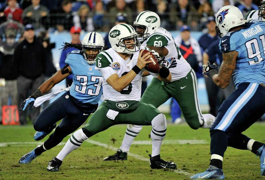 NASHVILLE, TN - DECEMBER 17:  Quarterback Mark Sanchez #6 of the New York Jets is pressured by Michael Griffin #33 of the Tennessee Titans at LP Field on December 17, 2012 in Nashville, Tennessee.  (Photo by Frederick Breedon/Getty Images) Photo: Frederick Breedon / 2012 Getty Images