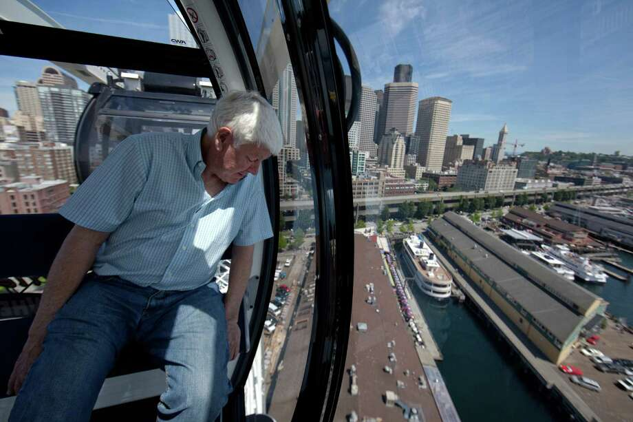 June 27, 2012 — Hal Griffith, owner of Seattle's Pier 57, rides on the Seattle Great Wheel. The observation wheel on the Seattle waterfront takes riders more than 175 feet over Puget Sound, offering a new view of the Seattle waterfront. Photo: JOSHUA TRUJILLO / SEATTLEPI.COM