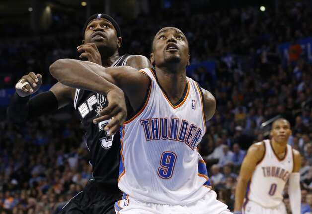 Oklahoma City Thunder forward Serge Ibaka (9) and San Antonio Spurs guard Stephen Jackson (3) fight for position during a foul shot in the fourth quarter of an NBA basketball game in Oklahoma City, Monday, Dec. 17, 2012. Oklahoma City won 107-93.  (Sue Ogrocki / Associated Press)