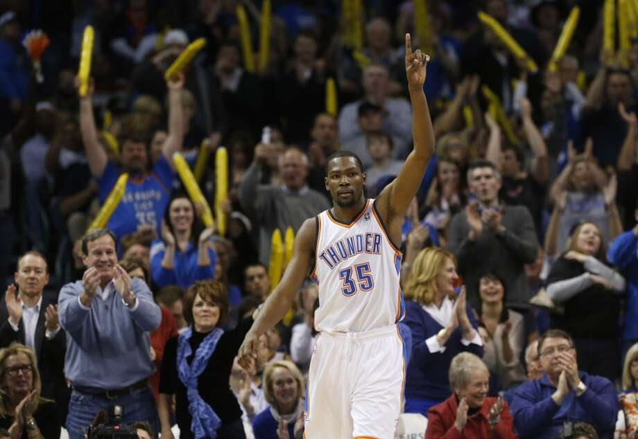 Oklahoma City Thunder forward Kevin Durant (35) and the crowd react to a dunk by Durant against the San Antonio Spurs in the fourth quarter of an NBA basketball game in Oklahoma City, Monday, Dec. 17, 2012. Oklahoma City won 107-93.  (Sue Ogrocki / Associated Press)