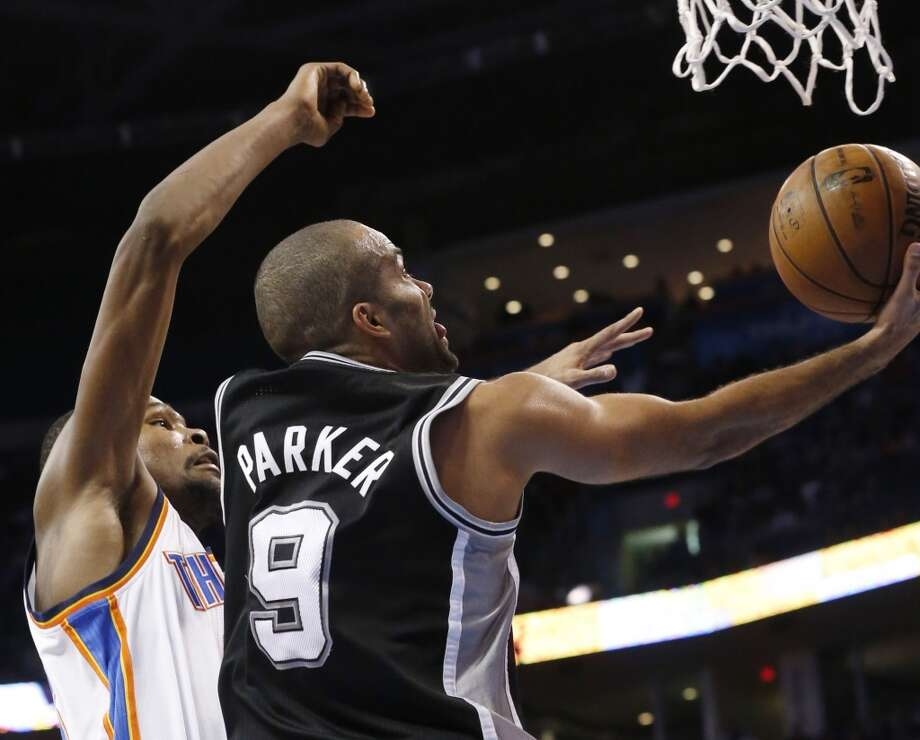San Antonio Spurs guard Tony Parker (9) shoots in front of Oklahoma City Thunder forward Kevin Durant (35) in the third quarter of an NBA basketball game in Oklahoma City, Monday, Dec. 17, 2012. Oklahoma City won 107-93.  (Sue Ogrocki / Associated Press)