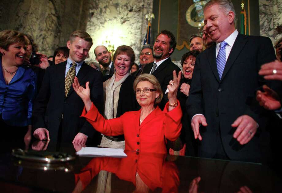 February 13, 2012— Governor Chris Gregoire celebrates with legislators, including Rep. Jaimie Pedersen, left, and Sen. Ed Murray after the governor signed a bill legalizing gay marriage in Washington State at the Legislative Building of the Washington State Capitol in Olympia. Photo: JOSHUA TRUJILLO / SEATTLEPI.COM
