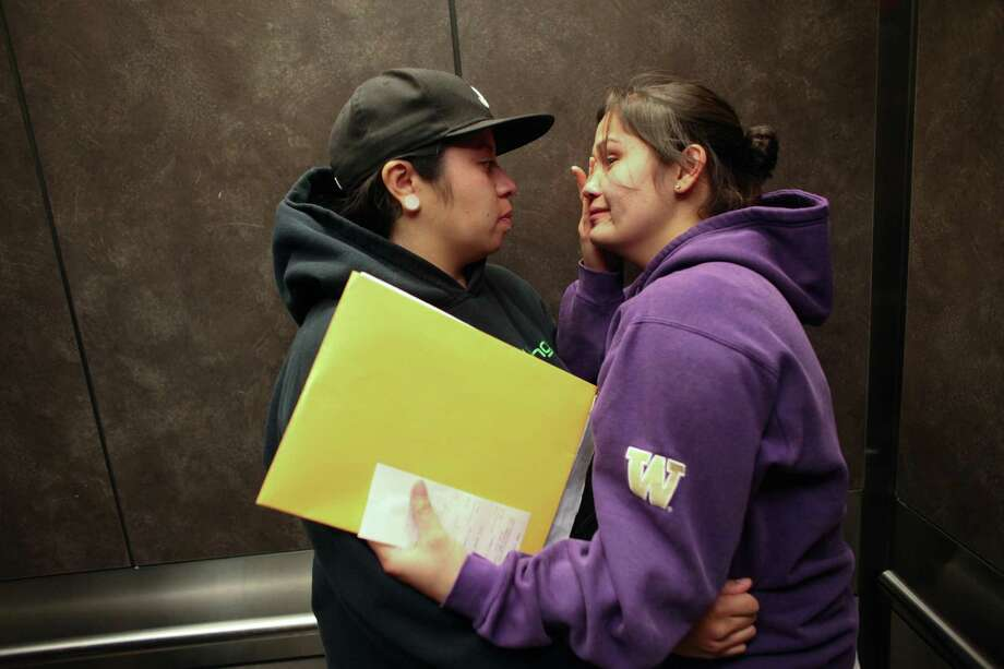 December 5, 2012 — Kelly Middleton, 24, and her partner Amanda Dollente, 29, embrace in an elevator after they received their marriage license at the King County Administration Building. They were first in line to get their marriage license after voters approved same-sex marriage in Washington State. Photo: JOSHUA TRUJILLO / SEATTLEPI.COM
