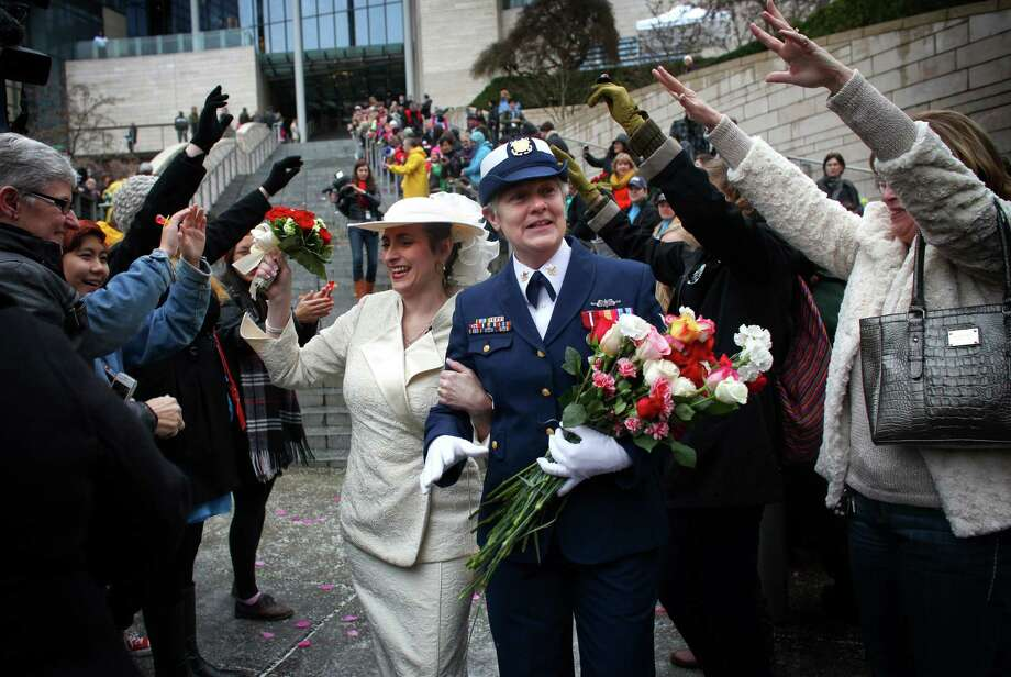 December 9, 2012— Deb Needham, left, and Nancy Monahan, a retired member of the U.S. Coast Guard, walk down the stairs of Seattle City Hall after they were married on the first day same-sex couples in Washington State could legally be married. Photo: JOSHUA TRUJILLO / SEATTLEPI.COM