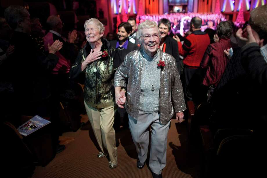 December 9, 2012 — Jane Lightly, left, and her wife Pete-e Petersen walk down the aisle after their wedding during a performance of the Seattle Men's Chorus at Benaroya Hall in Seattle on the first day same-sex couple in Washington State could legally marry. Photo: JOSHUA TRUJILLO / SEATTLEPI.COM