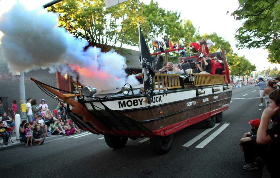 August 4, 2012— The Seafair Pirates fire their cannon during the Lake City 70th annual Pioneer Days Grand Parade. The annual festival includes a street fair, salmon bake and parade. Photo: JOSHUA TRUJILLO / SEATTLEPI.COM